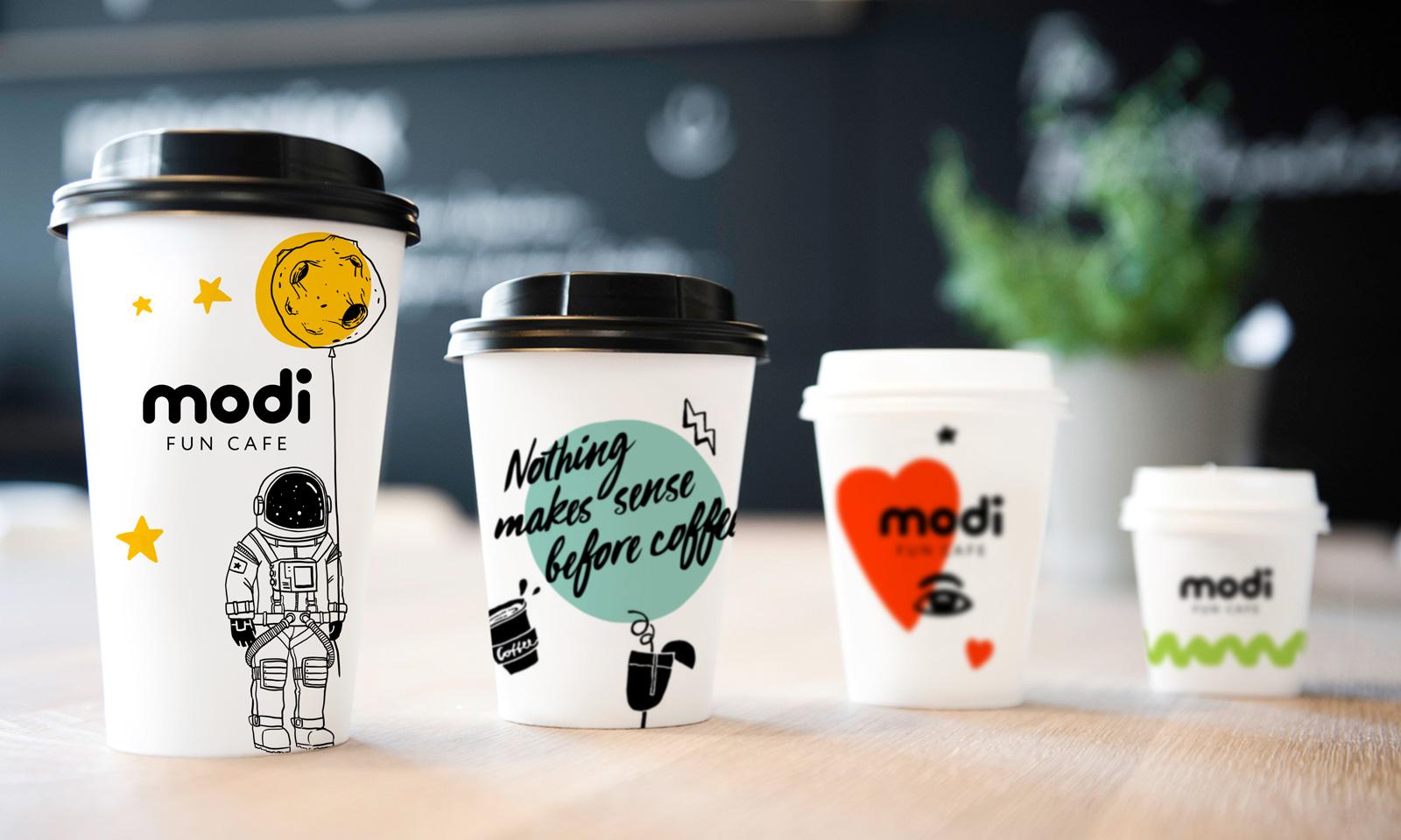 Modi Fun Cafe легко узнать по элементам фирменного стиля, которые вы найдете в пространстве бренда, дизайне упаковок, чашек и других элементов